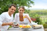 Fototapety Romantic breakfast in hotel garden