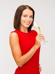 woman in red dress with a glass of champagne