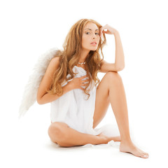 beautiful naked woman with white angel wings