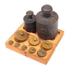 Set of a vintage weights for a old balance scale.