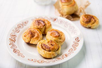 Brioches with cinnamon and glass of milk