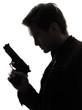 man killer policeman holding gun portrait silhouette