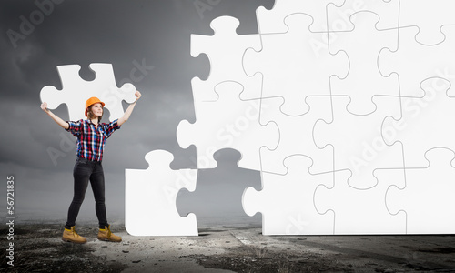 Woman engineer with puzzle