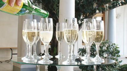 spilling champagne glasses