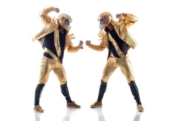 Strong young strippers posing in golden costumes
