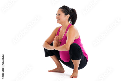 Pregnant woman squatting isolated on white