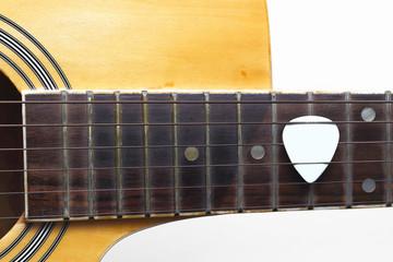 Guitar plectrum on guitar