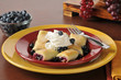Blueberry blintzes with whipped cream