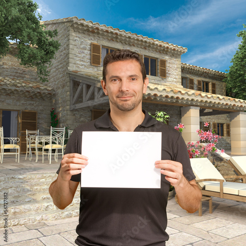 Man with message by beautiful house
