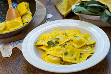 homemade ravioli pasta with sage butter sauce , italian food