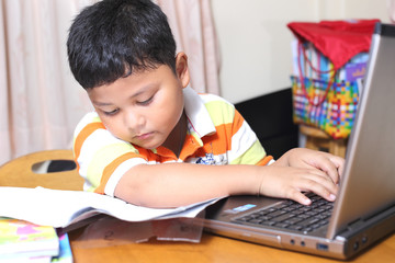 Asian boy work homework carefully.