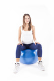 Woman sitting on fitness ball.