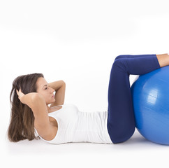 Sit-ups with fitness ball