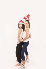 Two Santa Girls making gifts for Christmas holiday