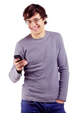 Joyful guy enjoying his mobile phone