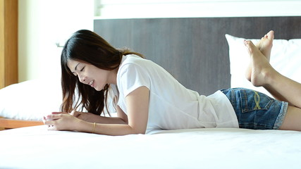 Asian woman teenager chat on cellphone