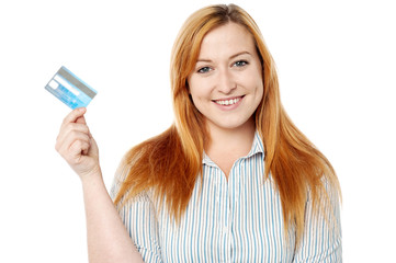 Young lady displaying her cash card