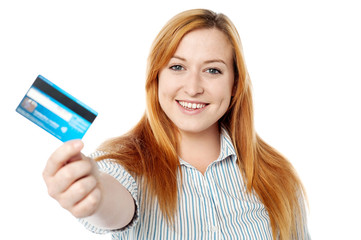 Young lady showing her cash card