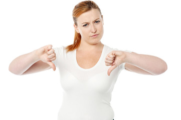 Young women showing thumbs down