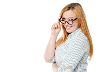 Young woman adjusting her eyeglasses