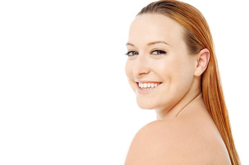 Smiling beautiful young spa woman