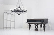 Light room with a piano, a folding screen and a chandelier - 56733270