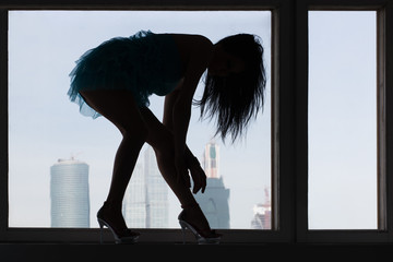 Silhouette of a woman in high-heeled shoes