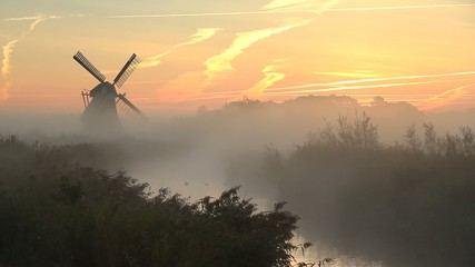 Autumn sunrise at windmill