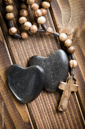 stone hearts with rosary beads