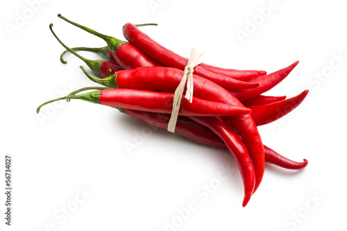 tied chili peppers on white background