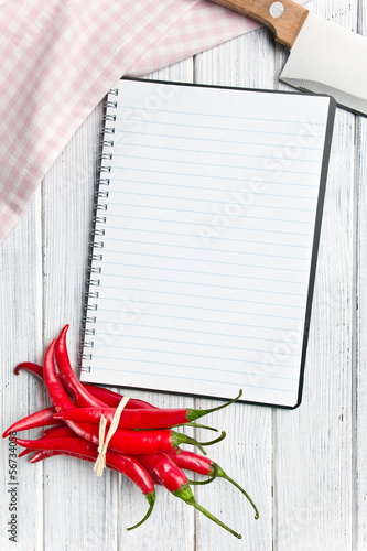 recipe book with chili peppers