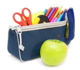 Apples and school case with accessories.