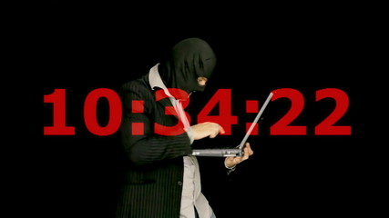 Masked criminal laptop cybercrime countdown