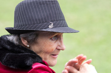 Senior woman with hat look ahead