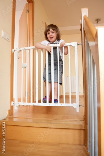 baby approaching safety gate of  stairs