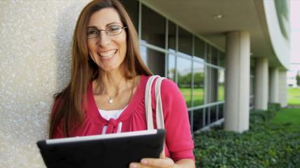 Caucasian Female Teacher Outside Modern Campus Close Up