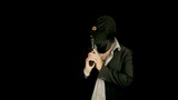Masked criminal with gun looking around