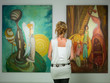 Leinwanddruck Bild - woman contemplating colorful paintings