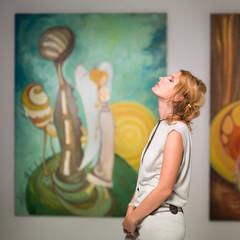 woman meditating in art gallery