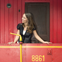 Woman Standing On A Red Caboose