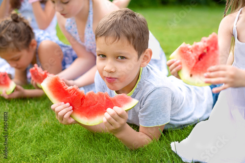 Children eating red watermelon