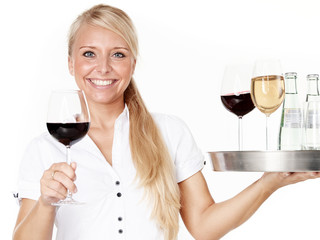 Pretty lady waitress with glasses of wine
