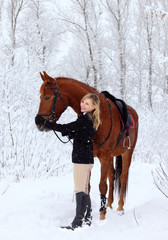Happy girl fondles horse