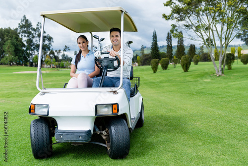 Couple in a golf cart