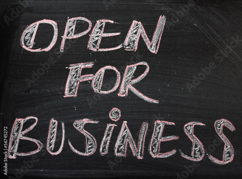 Open For Business sign on a Blackboard