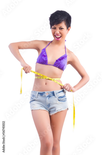 Woman in bikini in diet concept isolated on white