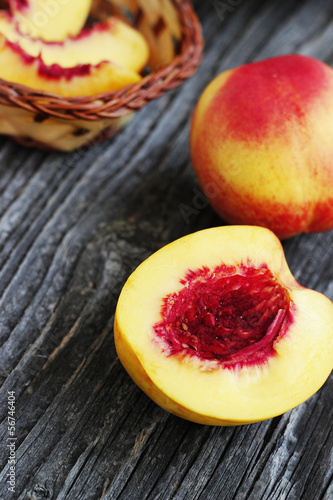 Whole and sliced nectarines
