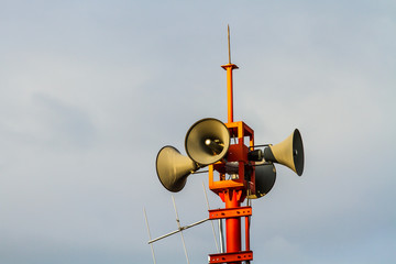 Four loudspeakers on post