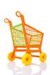 Plastic shopping cart against the white background