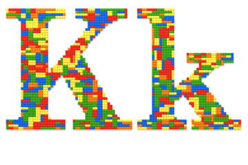 Letter K built from toy bricks in random colors